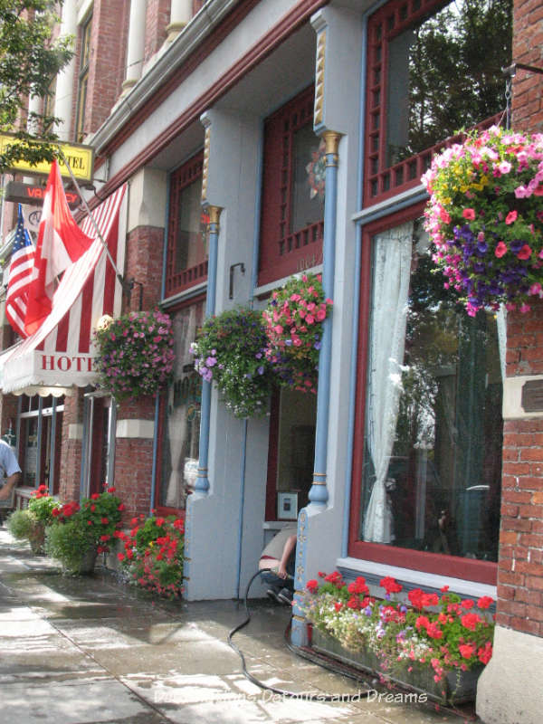 Brick exterior of Palace Hotel in Port Townsend decorated with hanging baskets of flowers