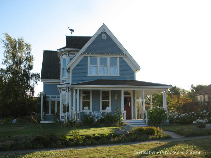 Blue two-story Victorian house with large veranda in Port Townsend, Washington
