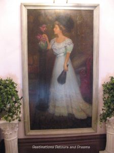 """Painting of """"Lady in Blue"""" in Palace Hotel, Port Townsend, Washington"""