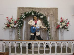 Life=size figure of Elvis playing guitar inside the Elvis Chapel at Superstition Museum