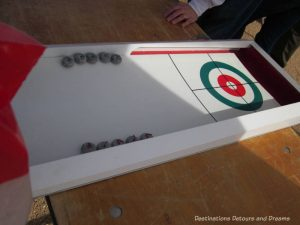 Tabletop curling game at The Great Canadian Picnic