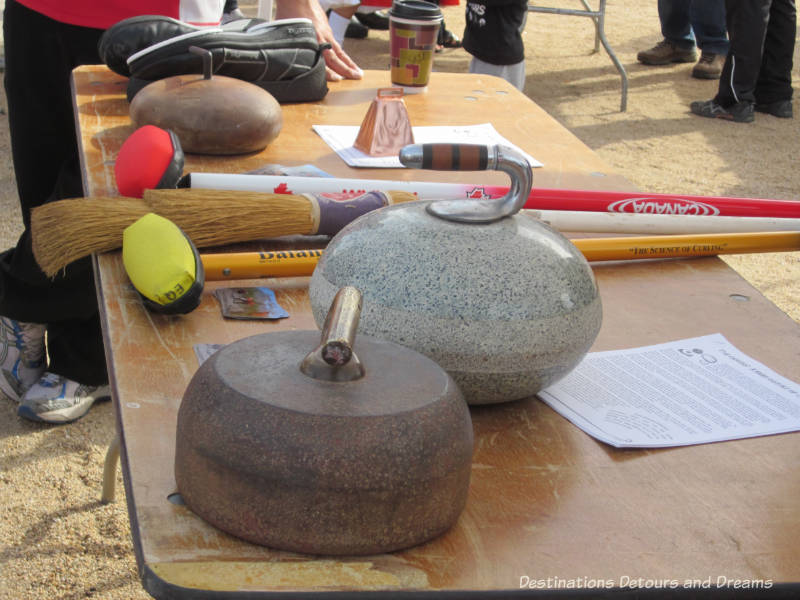 Curling rock and curling information sheets at The Great Canadian Picnic
