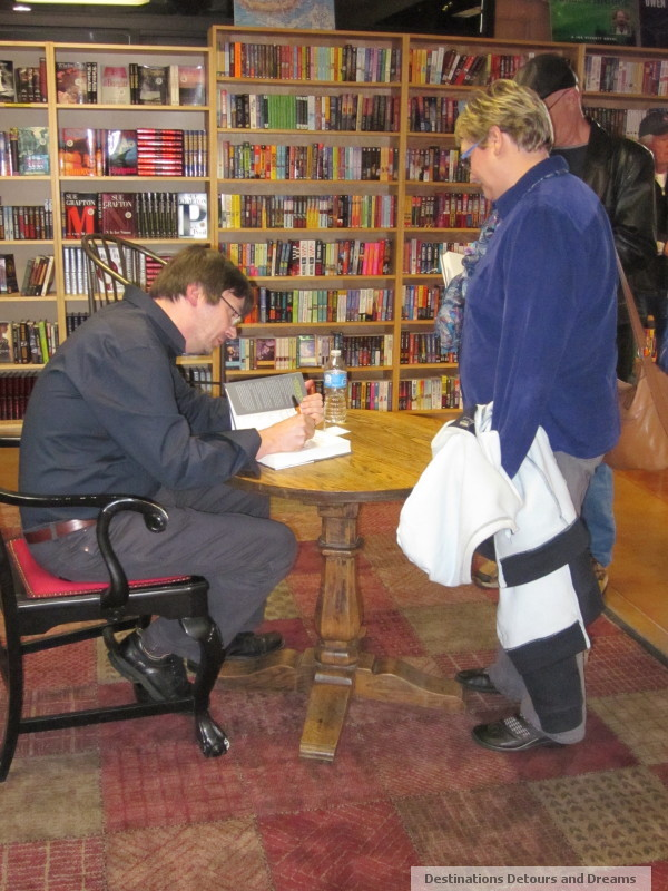 Ian Rankin signing my copy of Standing in Another Man's Grave at The Poisoned Pen Bookstore