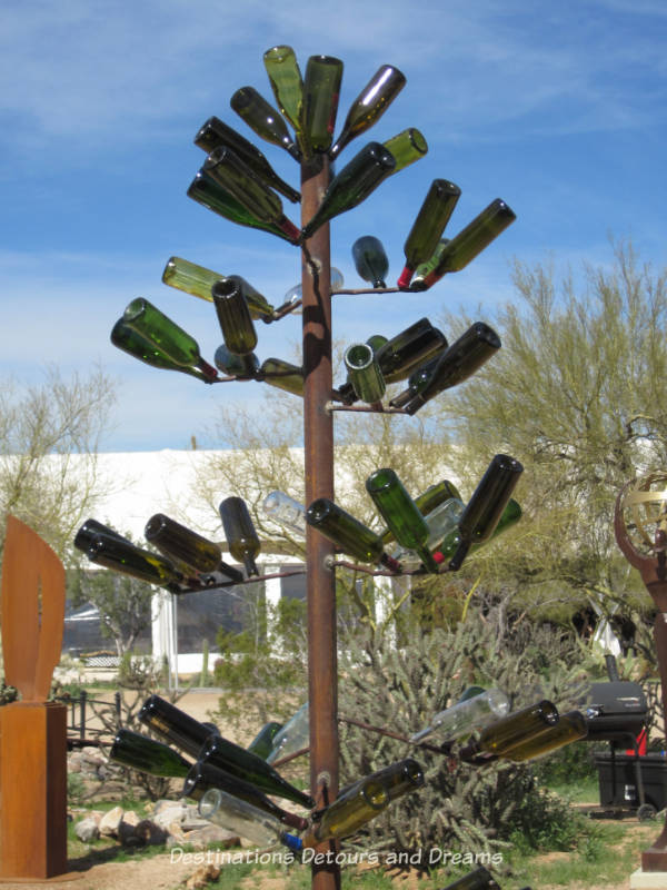 Sculpture made of wine bottles at In the Sculpture Courtyard at Arizona Fine Art Expo in Scottsdale Arizona