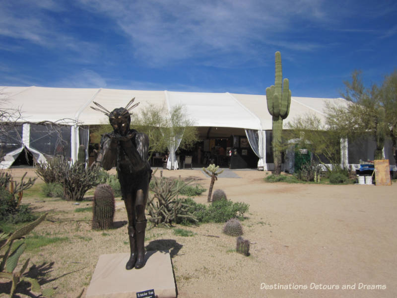 Kristofer Voss sculpture in foreground of sculpture garden at Arizona Fine Art Expo