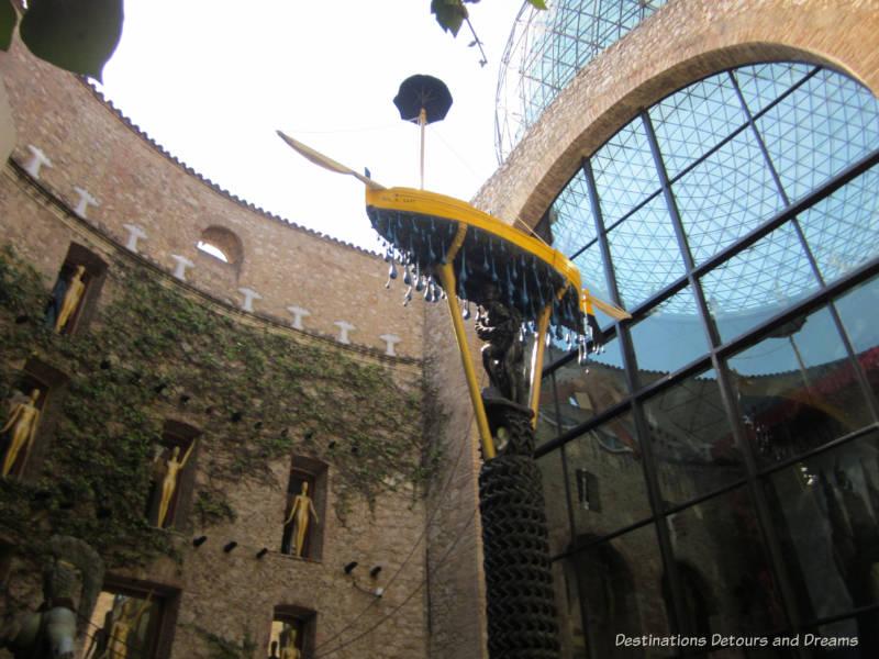 Boat raining tears in Dali Theatre-Museum atrium