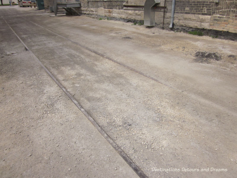 Remnants of old railway ties in Hell's Alley in Winnipeg's historic Exchange District - a walking tour of the East exchange area.