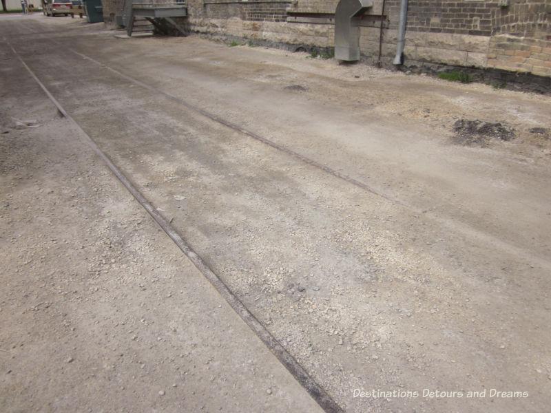 Remnants of old railway ties in Hell's Alley in Winnipeg's historic Exchange District - a walking tour of the East exchange area.