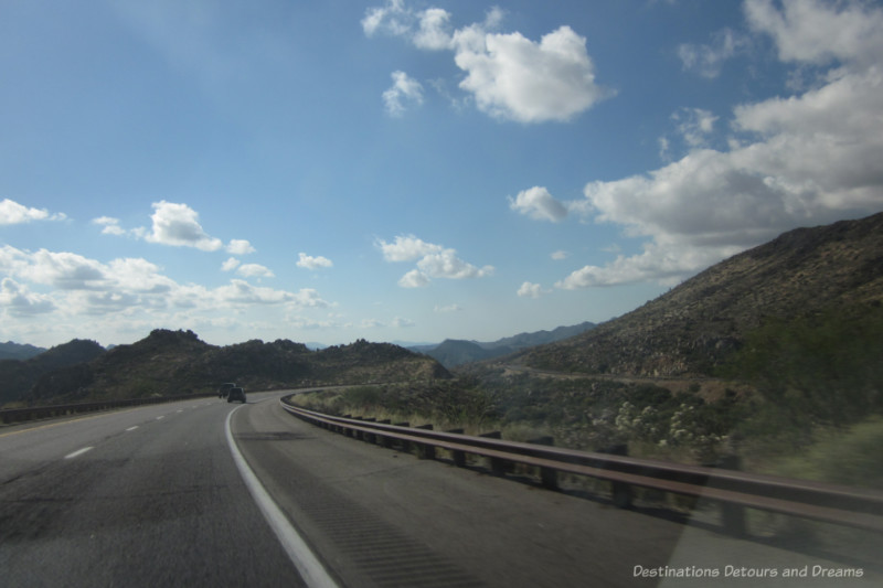 A highway curving through low mountains