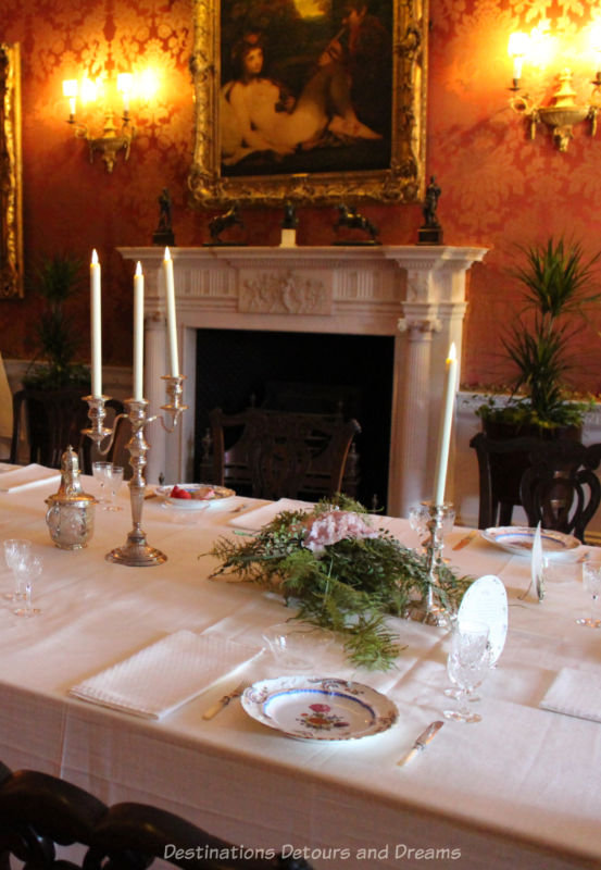 Elegant formal dining table with white fireplace in background