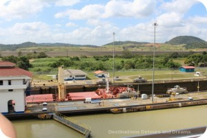 Ship being pulled through Miraflores Locks