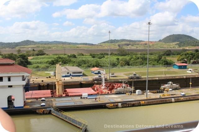 Ship being pulled through Miraflores Locks