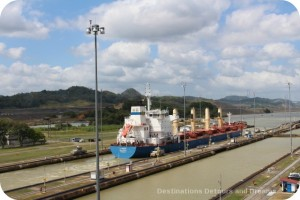 Ship pulled through Miraflores Locks