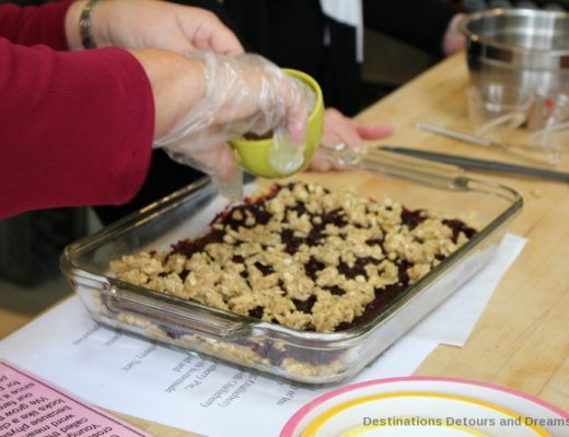 Adding crumble to the olallieberry bars