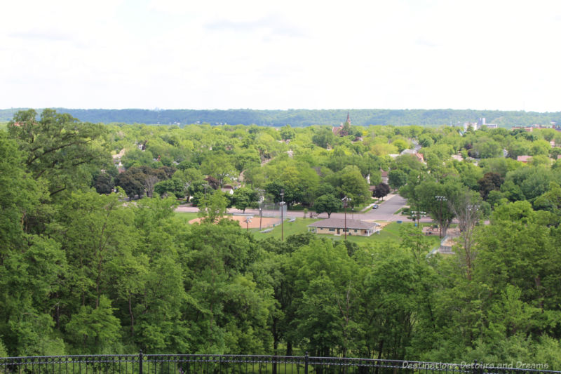 View of the town of New Ulm amid the green of trees from Hermann Heights Park
