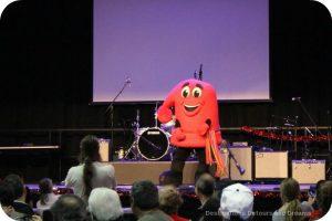Festival du Voyageur mascot does a jig