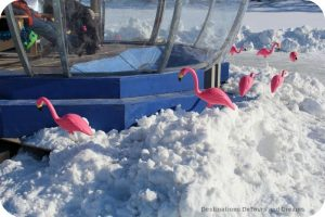 Flamingos surround a warming hut along the Red River Mutual Skating Trail in Winnipeg, Manitoba
