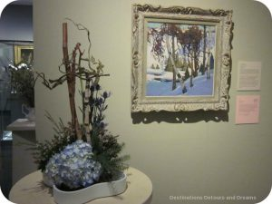 """Art in Bloom: a floral display inspired by art at the Winnipeg Art Gallery: design by Christina Kowalec inspired by Tom Thomson's """"Early Snow"""""""