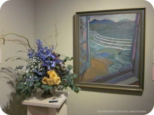 "Art in Bloom: a floral display inspired by art at the Winnipeg Art Gallery: design by Sharlene Nielsen inspired by Frederick Horsman Varley's ""View for the Artist's bedroom, Jericho Beach"""