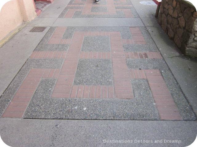 Shou symbol on sidewalk in Canada's oldest Chinatown, Victoria British Columbia