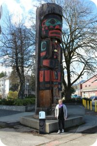 Cedar Man Walking out of the Log by Gwe-la-y-gwe-la-gya-les (Richard Hunt) totem pole in Duncan British Columbia (the City of Totems)