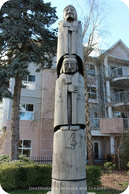 Cedar Woman and Man by Hwunu'metse' (Simon Charlie) totem pole in Duncan, British Columbia (the City of Totems)