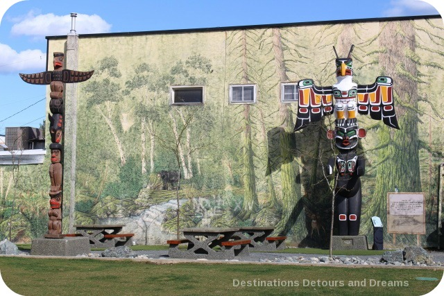 Totem poles and a mural in Duncan, British Columbia (the City of Totems)