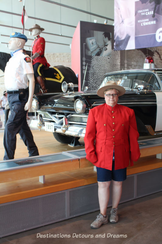 Canada Past and Present at RCMP Heritage Centre in Regina, Saskatchewan - trying on the uniform