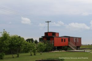 Train at Arborg and District Multicultural Heritage Village,where restored buildings preserve the past.