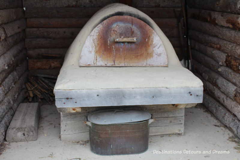 Ukrainian bake oven at Arborg and District Multicultural Heritage Village,where restored buildings preserve Manitoba's past.