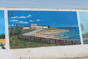 Gimli Seawall Gallery, a collection of murals on a protective wall on the pier, is a favourite tourist attraction in Gimli, Manitoba