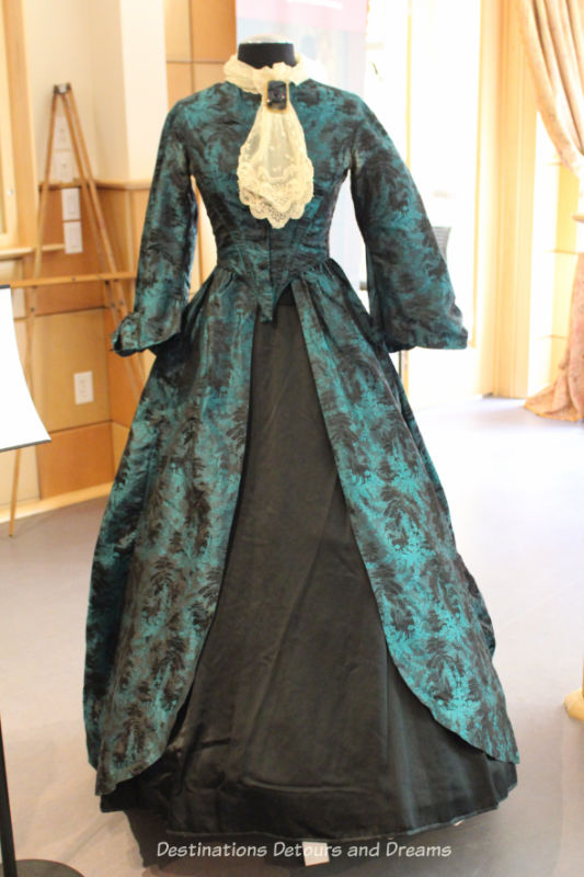 Woman's turquoise silk brocade opera gown from 1850. Dressing Up: Celebrating Canada's New Years Through The Decades. Highlights from the Eve of Elegance Exhibit by the Costume Museum of Canada.