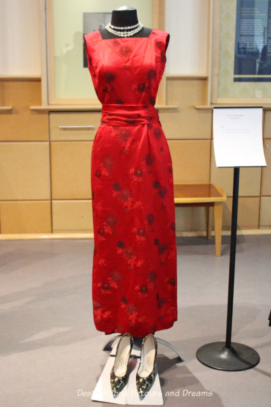 Chinese red silk brocade gown from 1959. Dressing Up: Celebrating Canada's New Years Through The Decades. Highlights from the Eve of Elegance Exhibit by the Costume Museum of Canada.