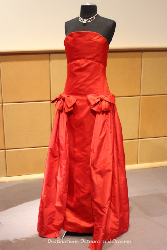 Arnold Scassi red satin strapless gown from the 1980s. Dressing Up: Celebrating Canada's New Years Through The Decades. Highlights from the Eve of Elegance Exhibit by the Costume Museum of Canada.