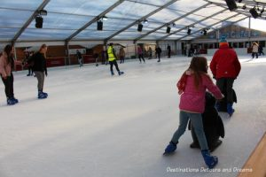 Ice rink at Winchester Christmas Market: A traditional German-style Christmas market on the grounds of historic Winchester Cathedral