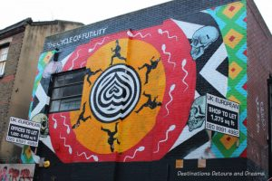 London street art in Shoreditch: The Cycle of Futility by INSA