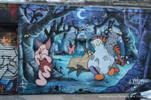 London street art in Shoreditch: cartoon characters in eerie night forest