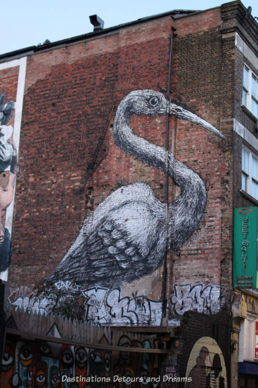 London street art in Brick Lane: crane by ROA