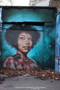 London street art in Brick Lane; painting of Myvanwy by Dreph,who protrrays the lives of strong, black women