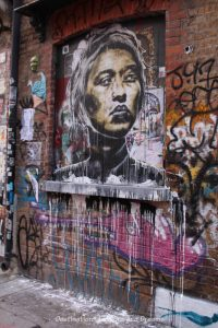 London street art in Shoreditch: lady's face and dripping paint