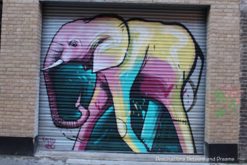 London street art in Brick Lane: coloured elephant by Falko One of Cape Town