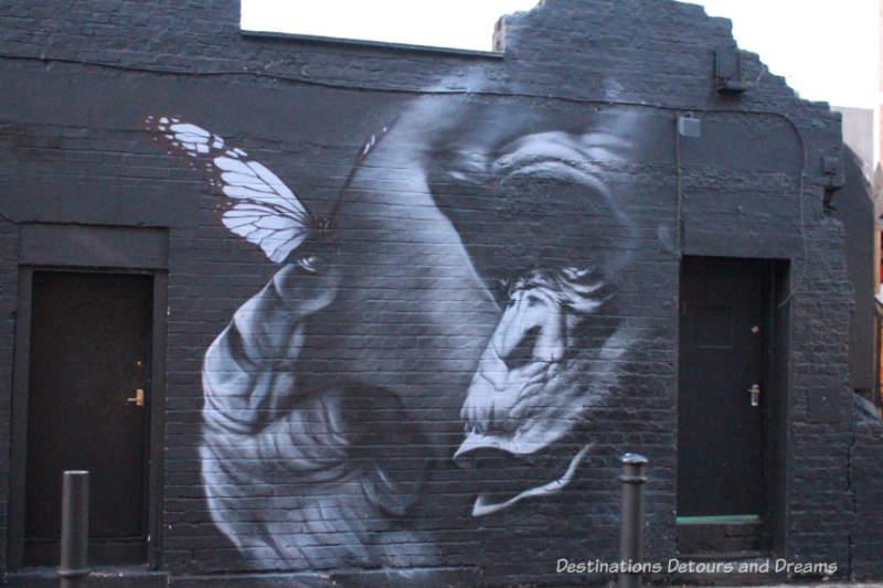 London street art in Brick Lane: grey-scale gorilla by Trafik