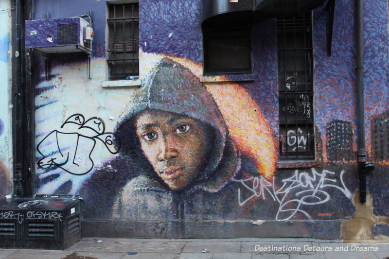 London street art in Shoreditch: painting on Whitby Street by Jimmy C