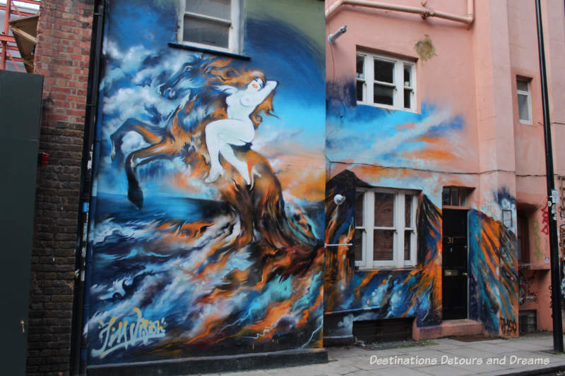 London street art in Shoreditch: woman on horse by Jim Vision