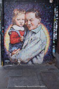 London street art in Brick Lane: man and child (Joe's Kid) by Jimmy C