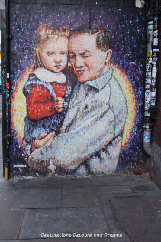 London street art in Brick Lane: man and child (Joe's Kid) by Jimmy C