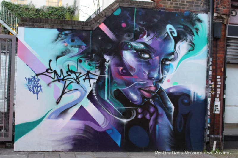 London street art in Brick Lane: purple face of a lady painted by Mr Cenz