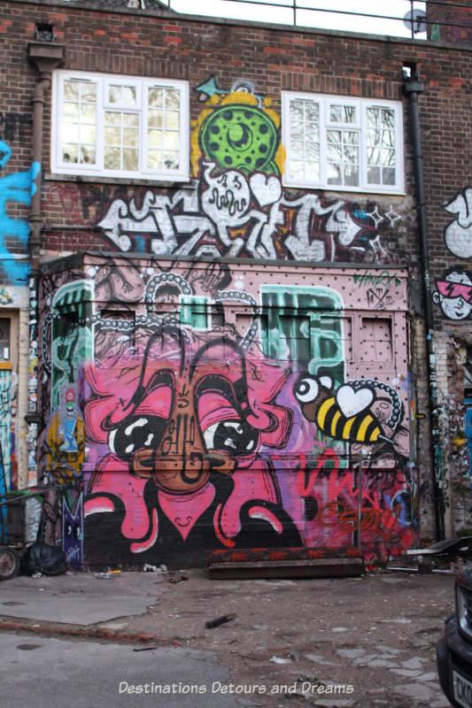 London street art in Brick Lane: Seven Stars