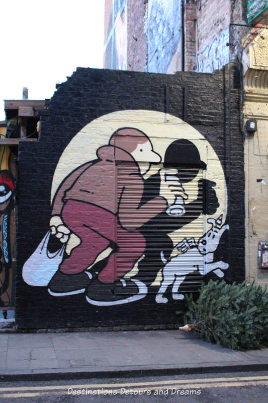 London street art in Brick Lane: shadow of a man and dog in a spotlight, painted by Muretz