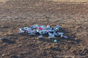 Paint cans litter field at Cadillac Ranch